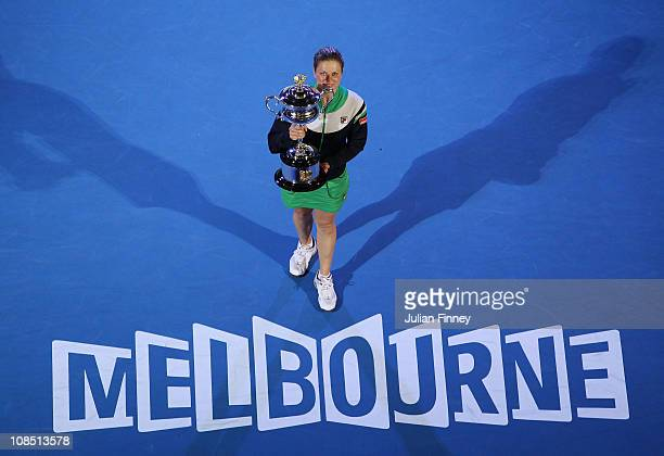 Kim Clijsters of Belgium poses with the Daphne Akhurst Trophy after winning her women's final match against Na Li of China during day thirteen of the...