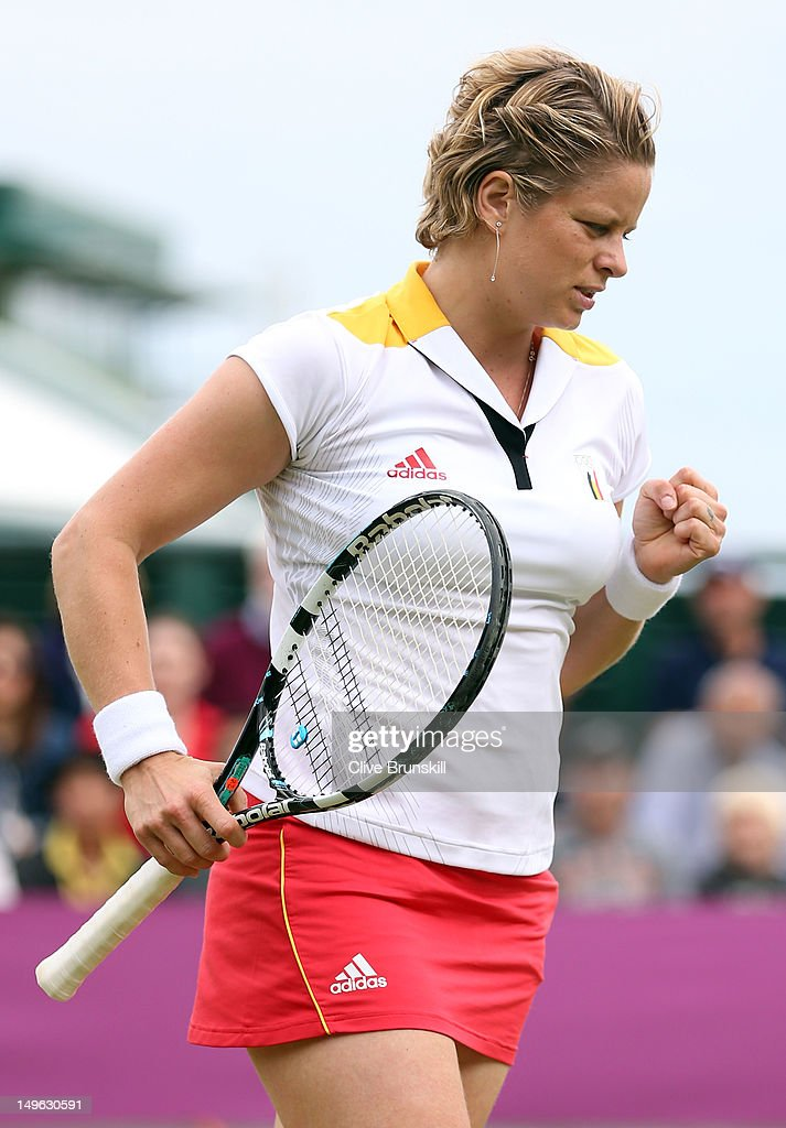 <a gi-track='captionPersonalityLinkClicked' href=/galleries/search?phrase=Kim+Clijsters&family=editorial&specificpeople=178302 ng-click='$event.stopPropagation()'>Kim Clijsters</a> of Belgium reacts after a point against Ana Ivanovic of Serbia on Day 5 of the London 2012 Olympic Games at Wimbledon on August 1, 2012 in London, England.