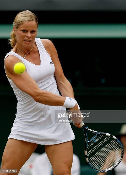 Kim Clijsters of Belgium returns a backhand to Na Li of China during day eight of the Wimbledon Lawn Tennis Championships at the All England Lawn...