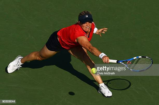 Kim Clijsters of Belgium returns a shot against Marion Bartoli of France during day three of the 2009 US Open at the USTA Billie Jean King National...