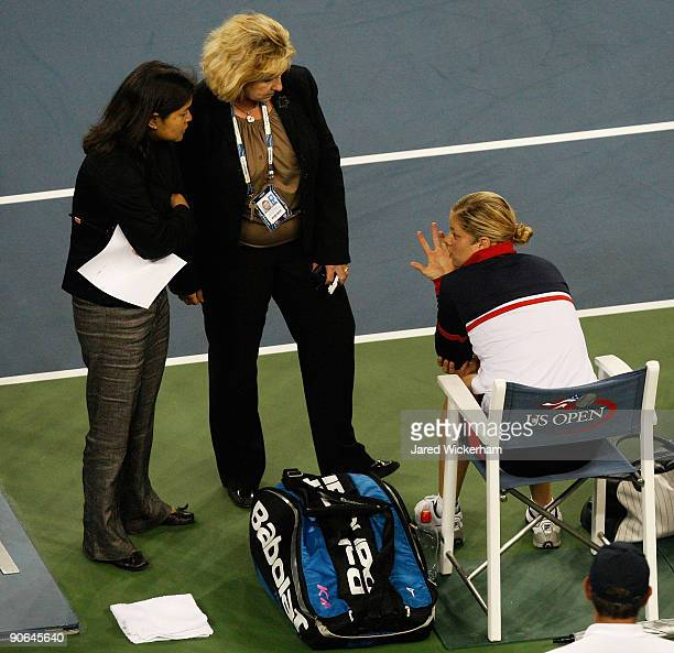 Kim Clijsters of Belgium talks to tournament officials after Serena Williams was disqualified for a conduct violation during the Women's Singles...