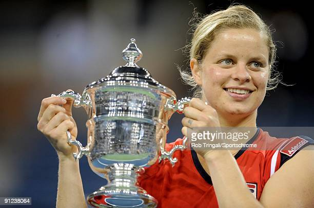Kim Clijsters of Belgium with the championship trophy after defeating Caroline Wozniacki of Denmark in the Women's Singles final on day fourteen of...