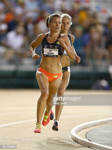 Kim Conley leads Jordan Hasay on the last lap on her way to win the Women's 10000 Meter on day 2 of the USATF Outdoor Championships at Hornet Stadium...