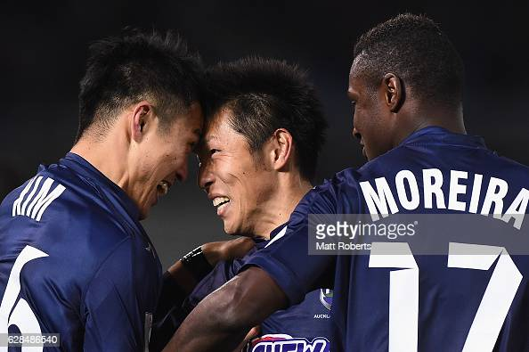 Kim Daewook of Auckland City celebrates kicking a goal with team mate Takuya Iwata during the FIFA Club World Cup Playoff for Quarter Final match...