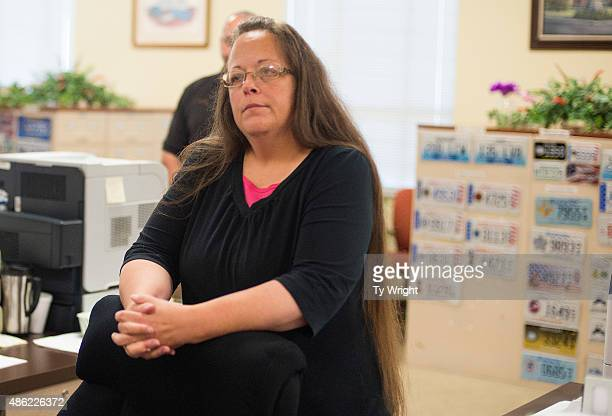 Kim Davis the Rowan County Clerk of Courts listens to Robbie Blankenship and Jesse Cruz as they speak with her at the County Clerks Office on...