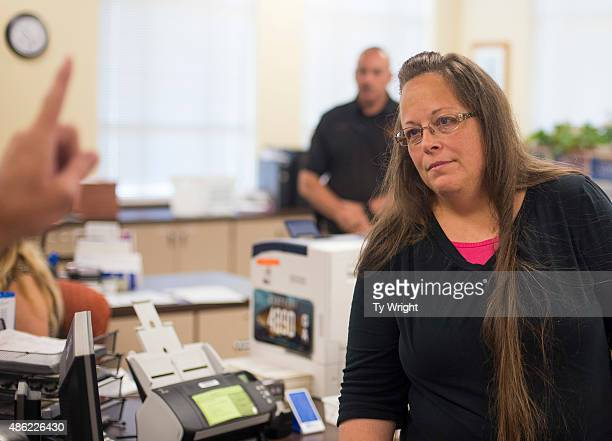 Kim Davis the Rowan County Clerk of Courts listens to Robbie Blankenship and Jesse Cruz as they speak with her about getting a marriage license at...
