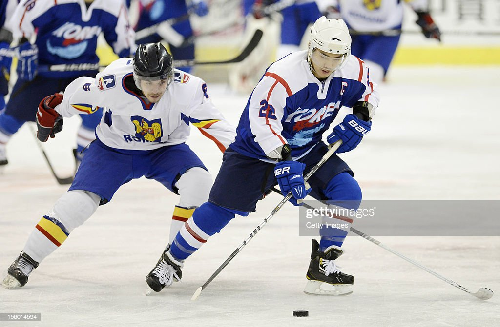 Kim Donghwan #22 of South Korea skates against Otto Biro #6 of Romania during the Ice Hockey Sochi Olympic Pre-Qualification Group J match between South Korea and Romania at Nikko Kirifuri Ice Arena on November 11, 2012 in Nikko, Tochigi, Japan. South Korea won 2-0.
