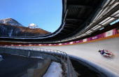 Kim Donghyeon of South Korea in action during a Men's Singles Luge training session ahead of the Sochi 2014 Winter Olympics at the Sanki Sliding...