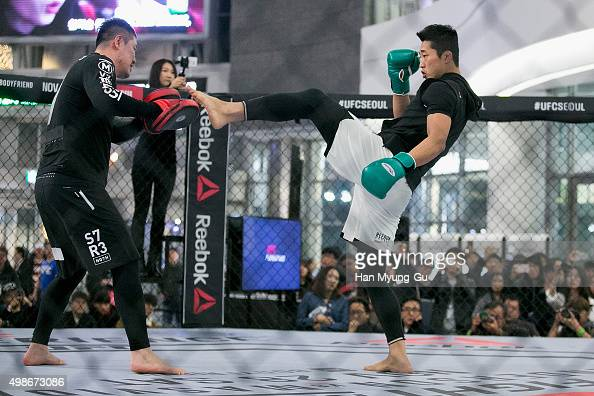 Kim DongHyun aka Dong Hyun Kim holds an open workout for fans and media during UFC Fight Night Open Workouts at Times Square on November 25 2015 in...