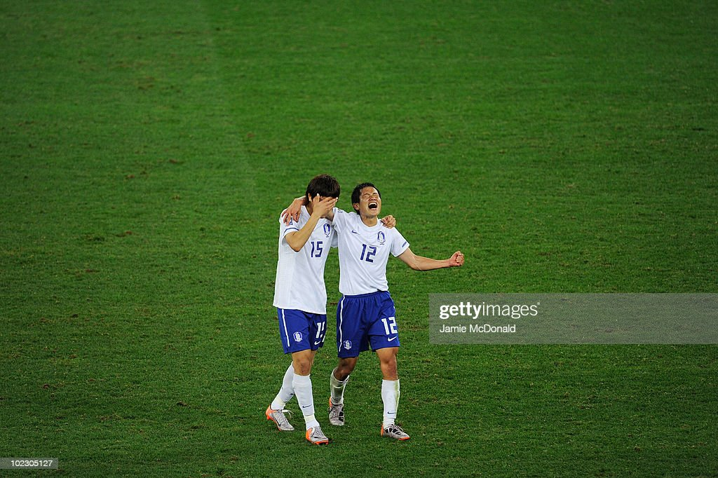 Kim DongJin and Lee YoungPyo of South Korea celebrate after victory in the 2010 FIFA World Cup South Africa Group B match between Nigeria and South...