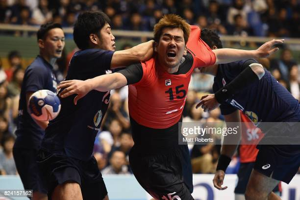 Kim Dongmyung of South Korea is challenged during the men's international match between Japan and South Korea at Komazawa Gymnasium on July 29 2017...