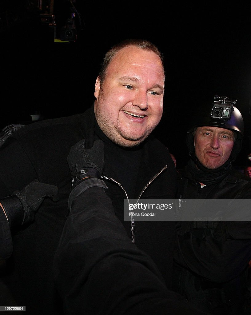 Kim Dotcom fools around with a fake swat team as he launches his new file-sharing site, Mega, on January 20, 2013 in Auckland, New Zealand. The launch comes as Dotcom continues to face extradition to the United States on copyright and racketeering charges in relation to his file sharing site, Megaupload.