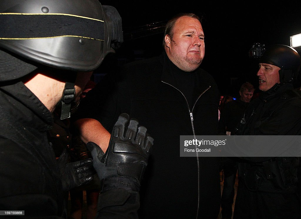 <a gi-track='captionPersonalityLinkClicked' href=/galleries/search?phrase=Kim+Dotcom&family=editorial&specificpeople=8806663 ng-click='$event.stopPropagation()'>Kim Dotcom</a> fools around with a fake swat team as he launches his new file-sharing site, Mega, on January 20, 2013 in Auckland, New Zealand. The launch comes as Dotcom continues to face extradition to the United States on copyright and racketeering charges in relation to his file sharing site, Megaupload.