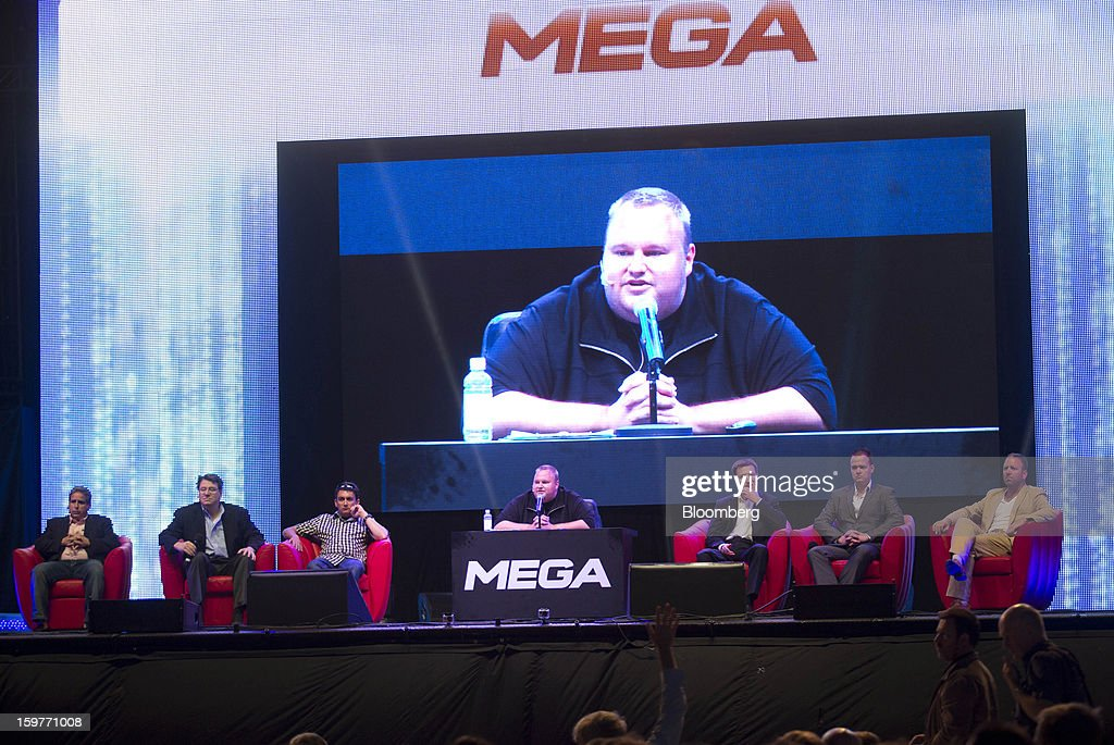 Kim Dotcom, founder of Megaupload.com, center, speaks during the launch of the company's new website Mega at his mansion in Coatesville, near Auckland, New Zealand, on Sunday, Jan. 20, 2013. Dotcom, marking one year since his Megaupload.com website was shut down by the U.S. Department of Justice and his home raided by New Zealand tactical squad officers in helicopters, unveiled his new website Mega, a successor file-storage and sharing site, saying innovation won't be stopped. Photographer: Brendon O'Hagan/Bloomberg via Getty Images