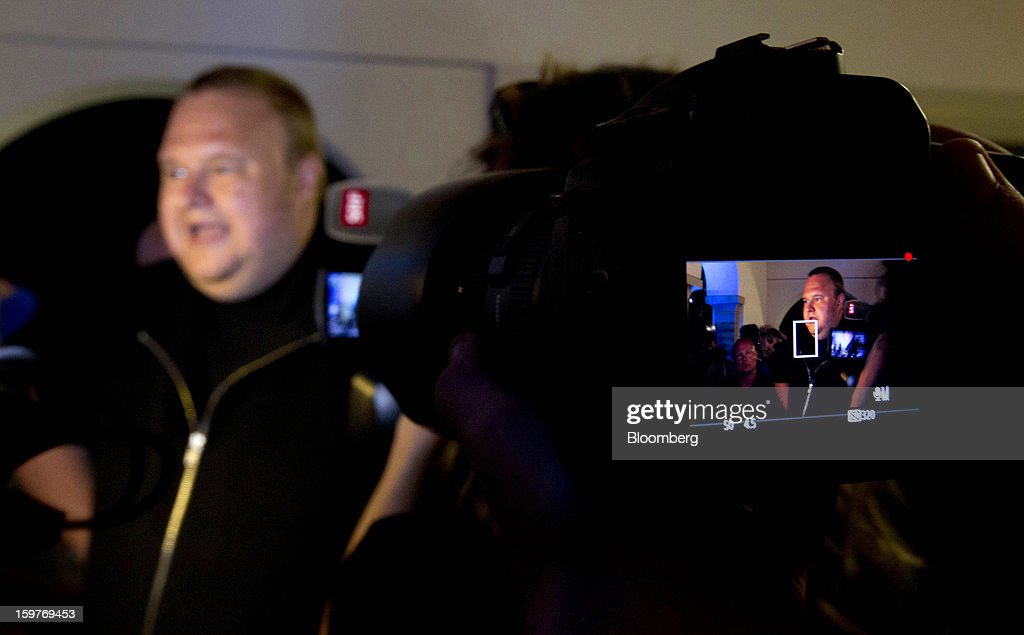 Kim Dotcom, founder of Megaupload.com, is seen in the view finder of a camera while speaking to members of the media at the launch of his new website Mega at his mansion in Coatesville, near Auckland, New Zealand, on Sunday, Jan. 20, 2013. Dotcom, marking one year since his Megaupload.com website was shut down by the U.S. Department of Justice and his home raided by New Zealand tactical squad officers in helicopters, unveiled his new website Mega, a successor file-storage and sharing site, saying innovation won't be stopped. Photographer: Brendon O'Hagan/Bloomberg via Getty Images