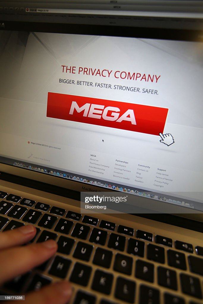 <a gi-track='captionPersonalityLinkClicked' href=/galleries/search?phrase=Kim+Dotcom&family=editorial&specificpeople=8806663 ng-click='$event.stopPropagation()'>Kim Dotcom</a>, founder of Megaupload.com, shows company's new website Mega on a computer screen during its launch in Coatesville, near Auckland, New Zealand, on Sunday, Jan. 20, 2013. Dotcom, marking one year since his Megaupload.com website was shut down by the U.S. Department of Justice and his home raided by New Zealand tactical squad officers in helicopters, unveiled his new website Mega, a successor file-storage and sharing site, saying innovation won't be stopped. Photographer: Brendon O'Hagan/Bloomberg via Getty Images