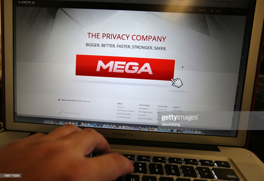 Kim Dotcom, founder of Megaupload.com, shows the company's new website Mega on a computer screen during its launch in Coatesville, near Auckland, New Zealand, on Sunday, Jan. 20, 2013. Dotcom, marking one year since his Megaupload.com website was shut down by the U.S. Department of Justice and his home raided by New Zealand tactical squad officers in helicopters, unveiled his new website Mega, a successor file-storage and sharing site, saying innovation won't be stopped. Photographer: Brendon O'Hagan/Bloomberg via Getty Images