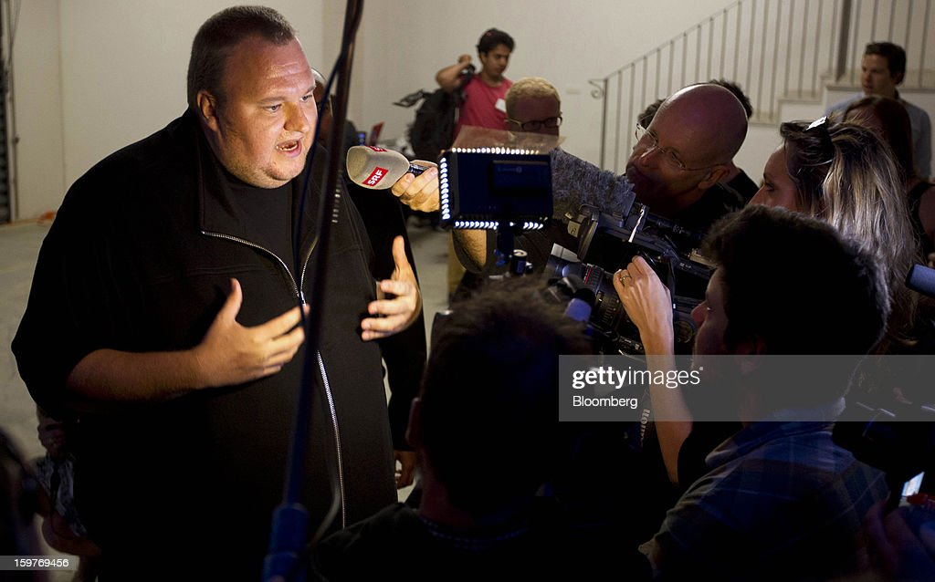 Kim Dotcom, founder of Megaupload.com, speaks to members of the media during the launch of the company's new website Mega at his mansion in Coatesville, near Auckland, New Zealand, on Sunday, Jan. 20, 2013. Dotcom, marking one year since his Megaupload.com website was shut down by the U.S. Department of Justice and his home raided by New Zealand tactical squad officers in helicopters, unveiled his new website Mega, a successor file-storage and sharing site, saying innovation won't be stopped. Photographer: Brendon O'Hagan/Bloomberg via Getty Images