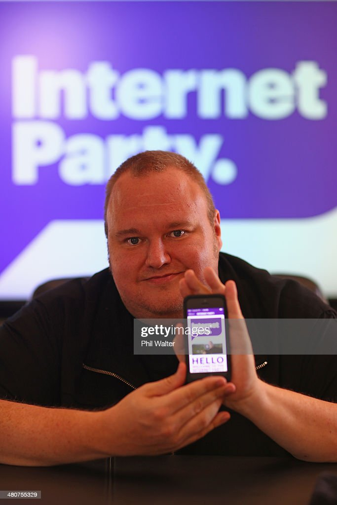 <a gi-track='captionPersonalityLinkClicked' href=/galleries/search?phrase=Kim+Dotcom&family=editorial&specificpeople=8806663 ng-click='$event.stopPropagation()'>Kim Dotcom</a> poses for a portrait with his smartphone app after the Internet Party was launched at the Dotcom Mansion on March 27, 2014 in Auckland, New Zealand. The Internet Party today launched its membership drive with members paying $1.29 to join up.
