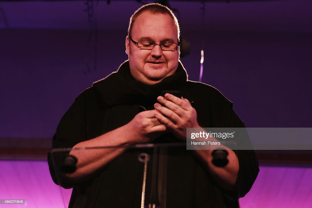 <a gi-track='captionPersonalityLinkClicked' href=/galleries/search?phrase=Kim+Dotcom&family=editorial&specificpeople=8806663 ng-click='$event.stopPropagation()'>Kim Dotcom</a> sends a tweet from his phone during a press conference announcing former leader of the Alliance Party, Laila Harre as leader of the Internet Party at the Langham Hotel on May 29, 2014 in Auckland, New Zealand. <a gi-track='captionPersonalityLinkClicked' href=/galleries/search?phrase=Kim+Dotcom&family=editorial&specificpeople=8806663 ng-click='$event.stopPropagation()'>Kim Dotcom</a> formed the Internet Party earlier this year to contest in the 2014 New Zealand elections in partnership with the Mana party.