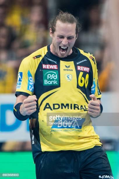 Kim Ekdahl du Rietz of RheinNeckar Loewen celebrates during the DKB HBL match between RheinNeckar Loewen and THW Kiel at SAP Arena on May 31 2017 in...