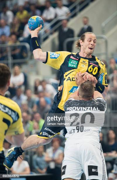 Kim Ekdahl du Rietz of RheinNeckar Loewen is challenged by Christian Zeitz of Kiel during the DKB HBL match between RheinNeckar Loewen and THW Kiel...
