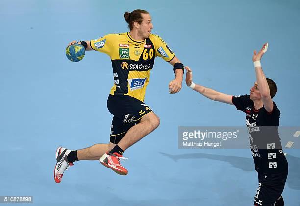 Kim Ekdahl Du Rietz of RheinNeckar Loewen is challenged by Holger Glandorf of SG Flensburg Handewitt during the DKB HBL Bundesliga match between...