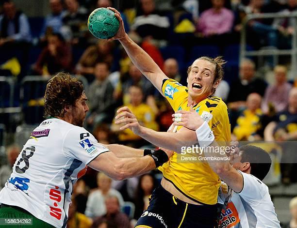 Kim Ekdahl du Rietz of RheinNeckar Loewen is challenged by Pavel Horak and Bojan Beljanski of Goeppingen during the DKB Handball Bundesliga match...