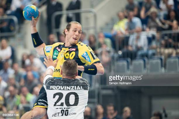 Kim Ekdahl du Rietz of RheinNeckar Loewen tries to score against Christian Zeitz of Kiel during the DKB HBL match between RheinNeckar Loewen and THW...