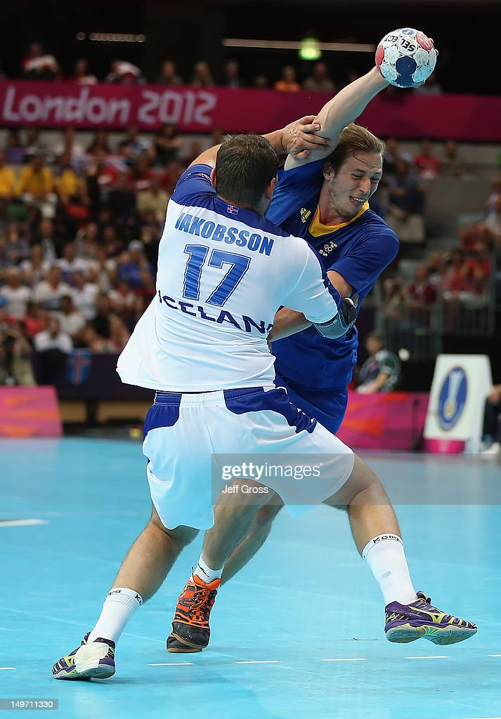 Kim Ekdahl du Rietz #25 of Sweden is defended by Sverre Jakobsson #17 of Iceland in the Men's Preliminaries Group A match between Sweden and Iceland on Day 6 of the London 2012 Olympic Games at The Copper Box on August 2, 2012 in London, England.