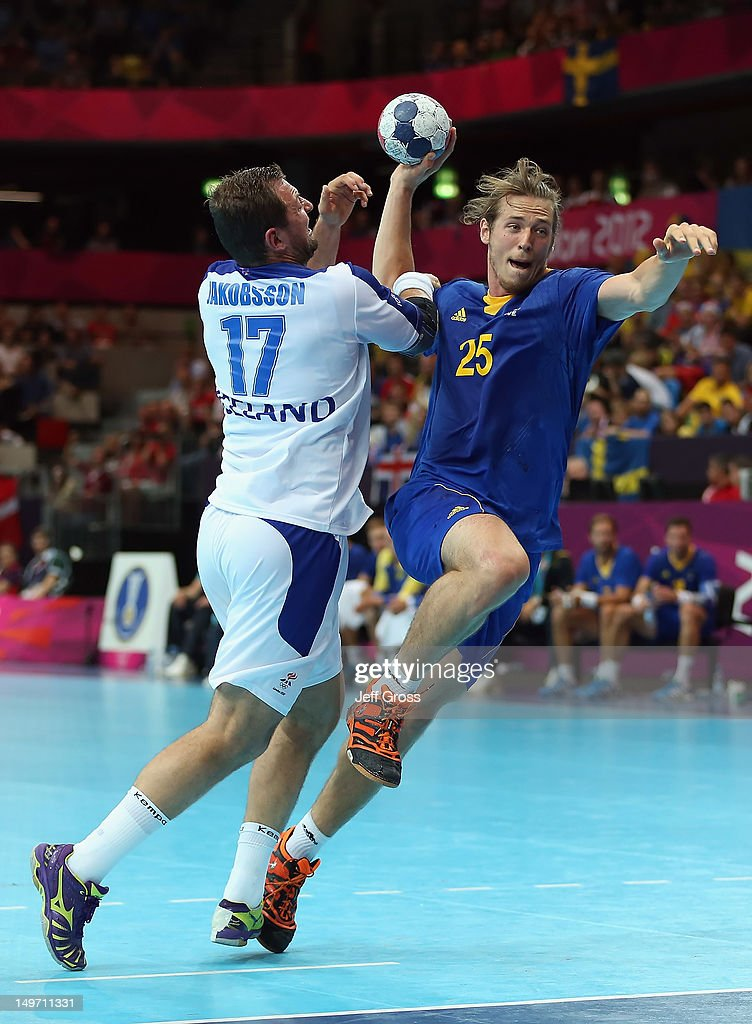 Kim Ekdahl du Rietz #25 of Sweden shoots past Sverre Jakobsson #17 of Iceland in the Men's Preliminaries Group A match between Sweden and Iceland on Day 6 of the London 2012 Olympic Games at The Copper Box on August 2, 2012 in London, England.