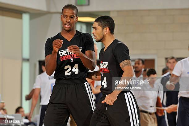 Kim English and Peyton Siva of the Detroit Pistons discuss the game against the Oklahoma City Thunder during the 2013 Southwest Airlines Orlando Pro...
