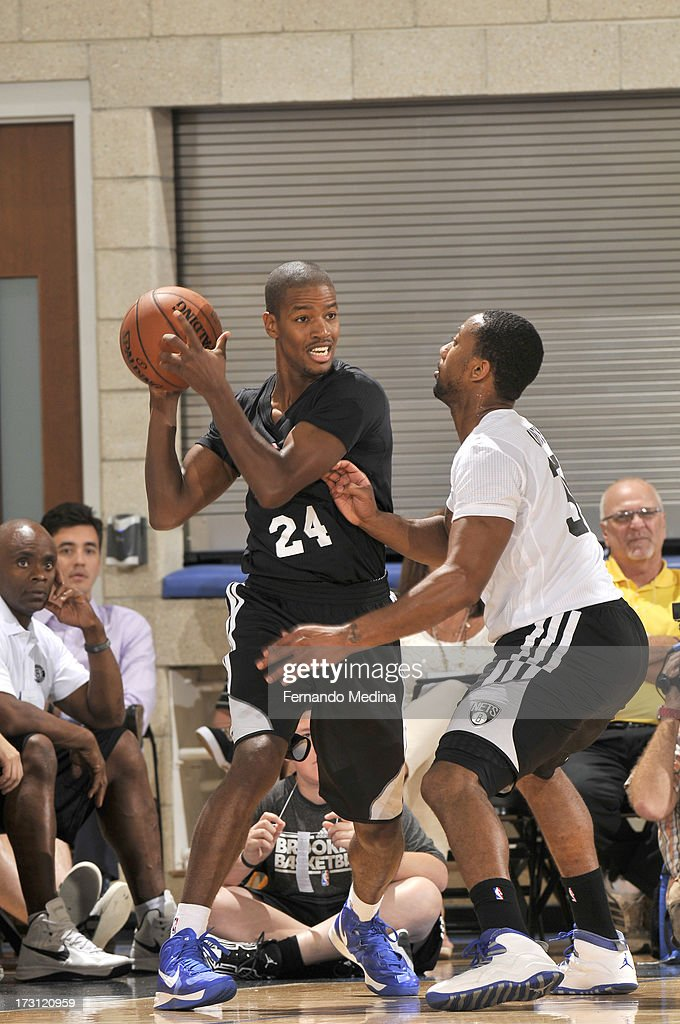 Kim English of the Brooklyn Nets protects the ball during the 2013 Southwest Airlines Orlando Pro Summer League game between the Detroit Pistons and...