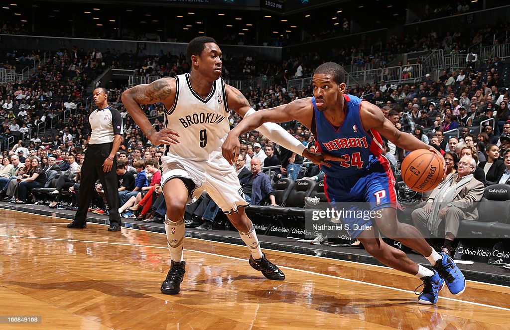 Kim English #24 of the Detroit Pistons dribbles against MarShon Brooks #9 of the Brooklyn Nets on April 17, 2013 at the Barclays Center in the Brooklyn borough of New York City.