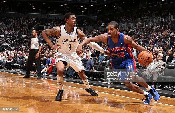 Kim English of the Detroit Pistons dribbles against MarShon Brooks of the Brooklyn Nets on April 17 2013 at the Barclays Center in the Brooklyn...
