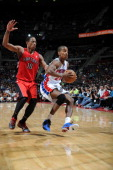 Kim English of the Detroit Pistons drives against DeMar DeRozan of the Toronto Raptors during the game between the Detroit Pistons and the Toronto...