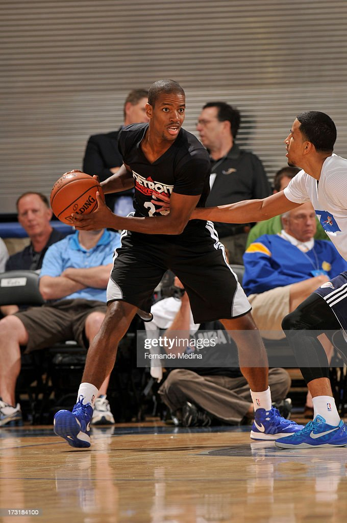 Kim English of the Detroit Pistons looks to pass against the Oklahoma City Thunder during the 2013 Southwest Airlines Orlando Pro Summer League on...