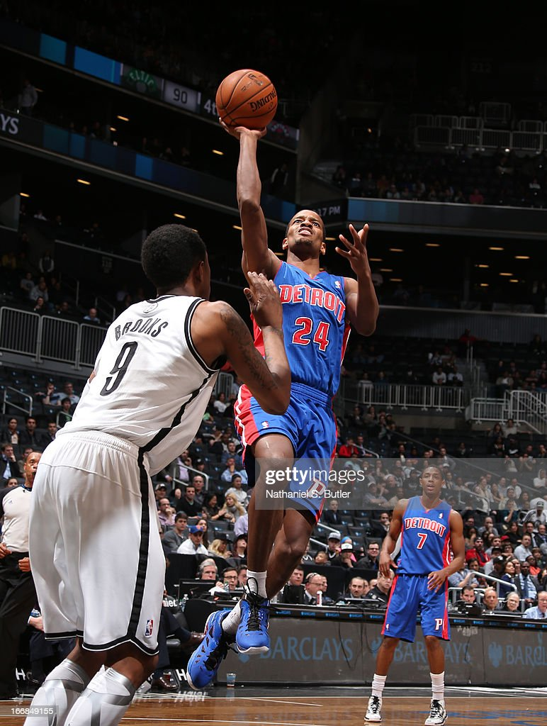 Kim English of the Detroit Pistons shoots against MarShon Brooks of the Brooklyn Nets on April 17 2013 at the Barclays Center in the Brooklyn borough...