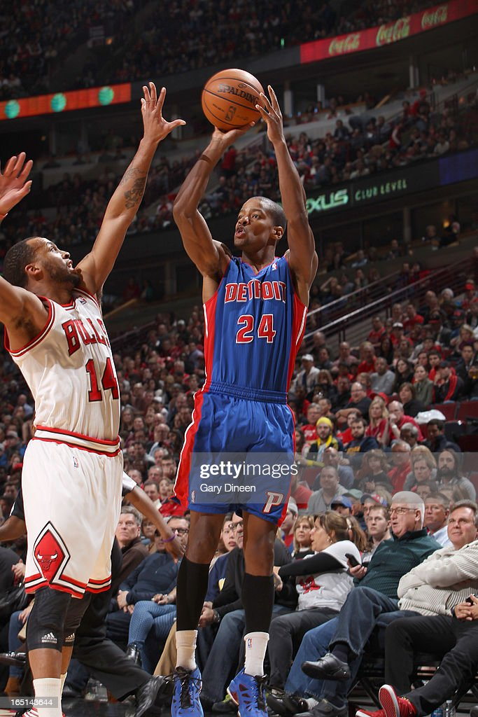 Kim English of the Detroit Pistons shoots over Daequan Cook of the Chicago Bulls on March 31 2013 at the United Center in Chicago Illinois NOTE TO...