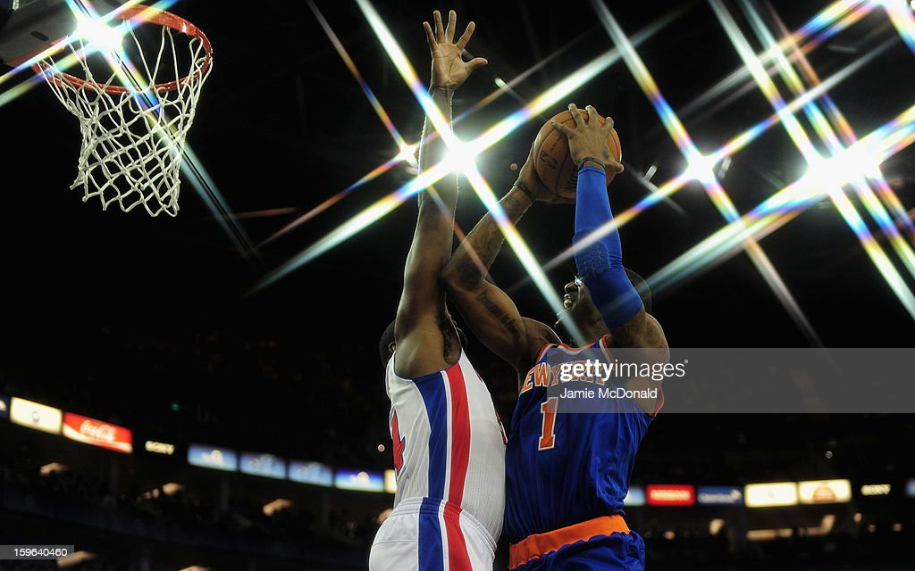 Kim English of the Detroit Pistons tries to block the shot from Amar'e Stoudemire of the New York Knicks during the NBA London Live 2013 game between New York Knicks and the Detroit Pistons at the O2 Arena on January 17, 2013 in London, England.