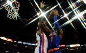 Kim English of the Detroit Pistons tries to block the shot from Amar'e Stoudemire of the New York Knicks during the NBA London Live 2013 game between...