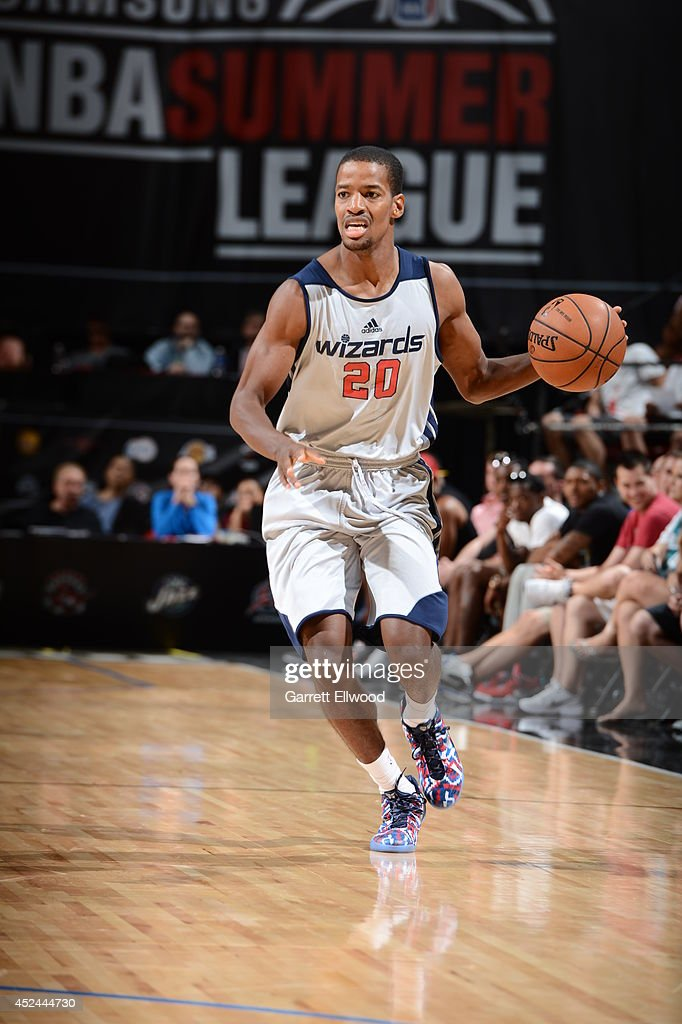 Kim English #20 of the Washington Wizards moves the ball up-court against the San Antonio Spurs at the Samsung NBA Summer League 2014 on July 19, 2014 at the Thomas and Mack Center in Las Vegas, Nevada.