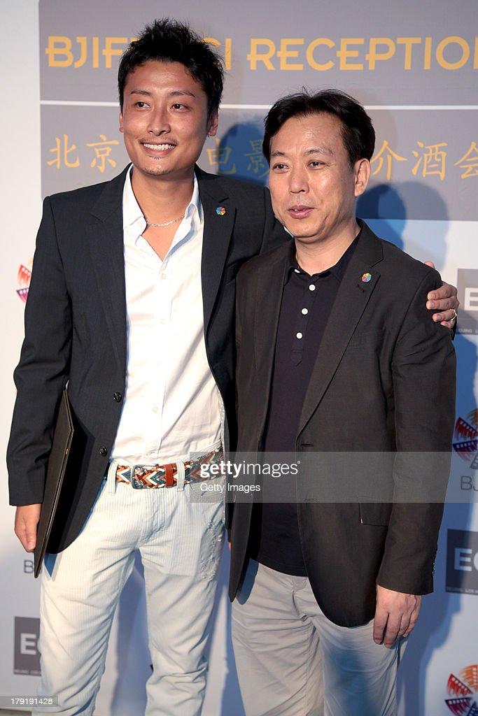 Kim Eui Suk (R) attends the Beijing International Film Festival (BJIFF) Organization Committee Reception during the 70th Venice International Film Festival at the Danieli Hotel - La Terrazza on August 31, 2013 in Venice, Italy.