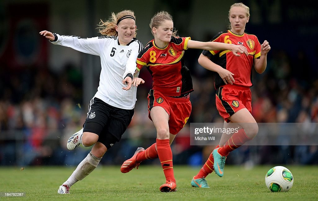 Kim Fellhauer (L) of Germany, Inne De Smet (C) and Bieke Vandenbussche of Belgium compete for the ball during the U17 Girls Euro Qualifier match between Germany and Belgium at Bioenergie-Arena on October 16, 2013 in Grossbardorf, Germany.