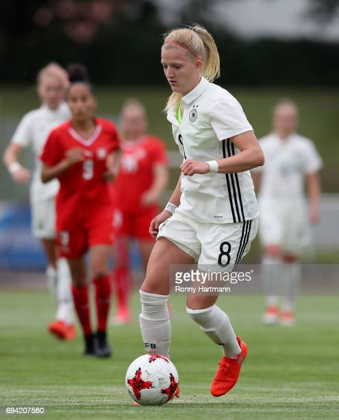 Kim Fellhauer of Germany runs with the ball during the U19 women's elite round match between Germany and Switzerland at Friedensstadion on June 9...