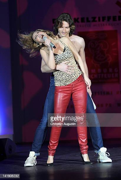 Kim Fisher and Pepe Munoz perform on the catwalk during the charity event 'Event Prominent' at the Hotel Grand Elysee on March 25 2012 in Hamburg...
