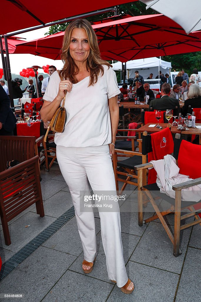 <a gi-track='captionPersonalityLinkClicked' href=/galleries/search?phrase=Kim+Fisher&family=editorial&specificpeople=693846 ng-click='$event.stopPropagation()'>Kim Fisher</a> during the 'Ein Herz fuer Kinder' summer party at Wannseeterrassen on May 26, 2016 in Berlin, Germany.