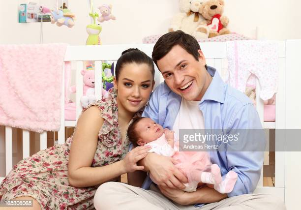 Kim Gloss Rocco Stark and their newborn baby daughter Amelia pose for a picture during a photo session on March 1 2013 in Berlin Germany