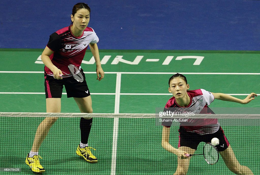 Kim Ha Na and Jung Kyung Eun of South Korea in action during the 2014 Singapore Open women's double round 1 match at Singapore Indoor Stadium on April 9, 2014 in Singapore.
