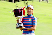 Kim HaNeul of South Korea poses for photographs with the trophy after winning the Munsingwear Ladies Tokai Classic at the Shin Minami Aichi Country...